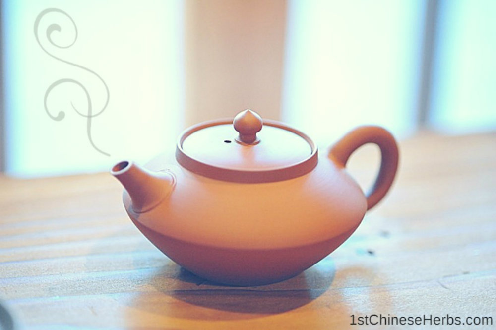 Step 6: Fill the teapot with boiling water.